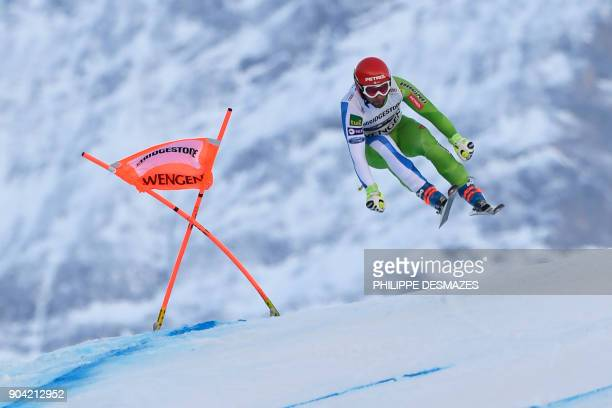 Slovenia's Martin Cater competes in the Downhill race of the men's Alpine Combined at the FIS Alpine Skiing World Cup in Wengen on January 12 2018 /...
