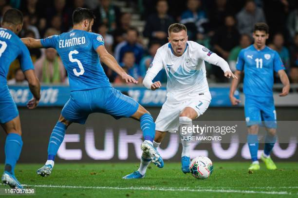 Slovenia's midfielder Josip Ilicic fights for the ball with Israel's defender Hatem Elhamed during the UEFA Euro 2020 Group G qualifying football...