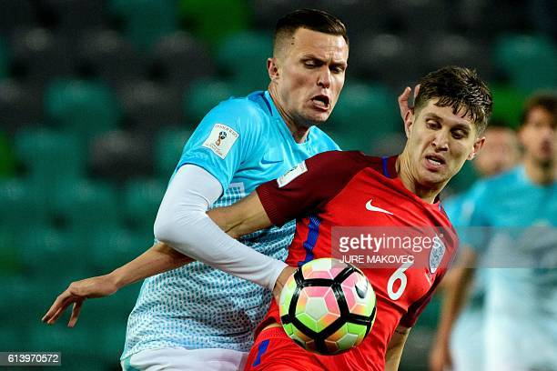Slovenia's midfielder Josip Ilicic vies for the ball with England's defender John Stones during the Fifa World Cup 2018 football qualification match...