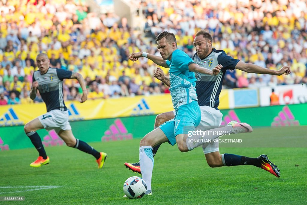 Slovenia's midfielder Josip Ilicic (C) vies with Sweden's defender Andreas Granqvist during the friendly football match between Sweden and Slovenia at Swedbank stadium in Malmo on May 30, 2016. / AFP / JONATHAN