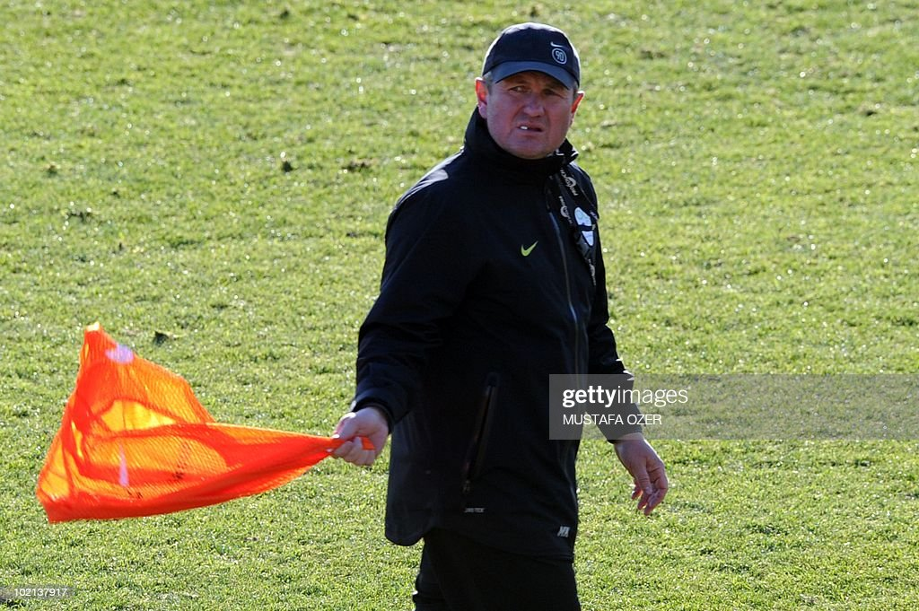 Slovenia's national team head coach Matjaz Kek walks on the pitch during a training session at Hyde Park High School stadium in Johannesburg, on June 16, 2010 during the 2010 World Cup in South Africa.