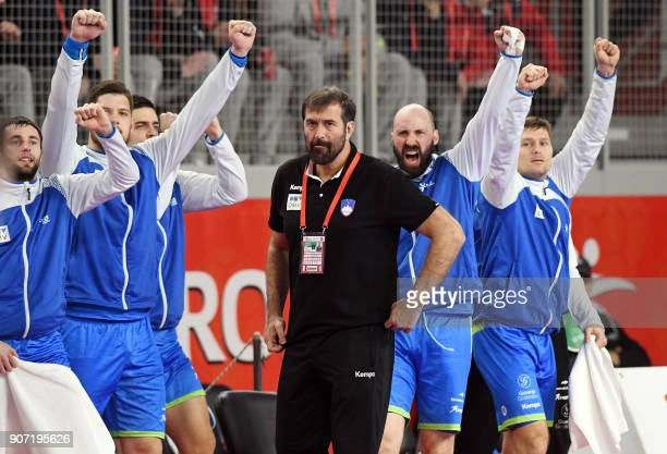 Slovenia's players and coach react during the group II match of the Men's 2018 EHF European Handball Championship between Slovenia and Denmark in...