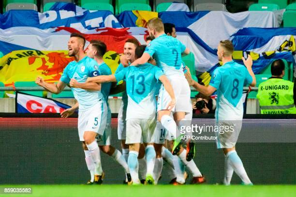 Slovenia's players celebrate after scoring a goal during the FIFA World Cup 2018 qualifier football match between Slovenia and Scotland at the...