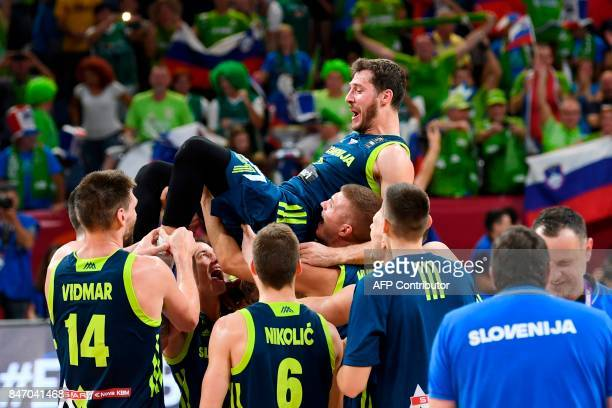 Slovenia's players celebrate their team's win after the FIBA Eurobasket 2017 men's semifinal basketball match between Spain and Slovenia at the...