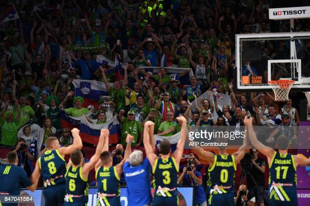 Slovenia's players celebrate their team's win with their supporters after the FIBA Eurobasket 2017 men's semifinal basketball match between Spain and...