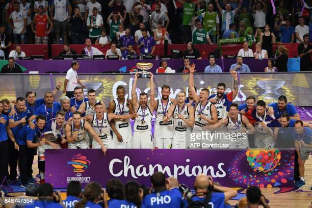 Slovenia's players celebrate with their trophy after defeating Serbia during the FIBA Eurobasket 2017 men's Final basketball match between Slovenia...