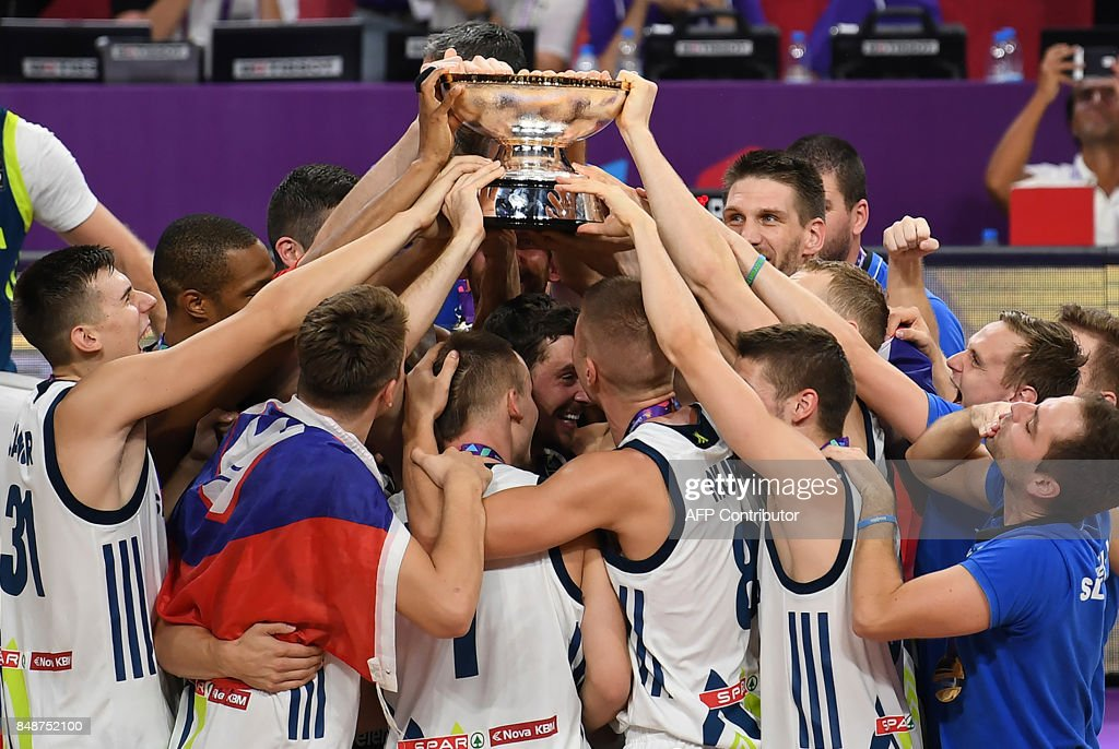 Slovenia's players celebrate with their trophy after defeating Serbia at the end of the FIBA Eurobasket 2017 men's Final basketball match between Slovenia and Serbia at Sinan Erdem Sport Arena in Istanbul on September 17, 2017. /