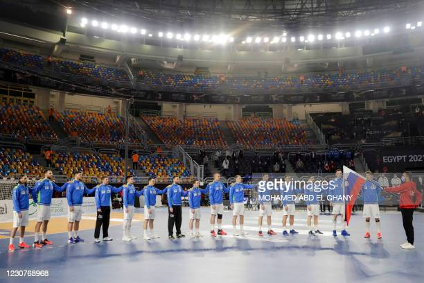 Slovenia's players listen to their national anthem during the 2021 World Men's Handball Championship match between Group IV teams Slovenia and Egypt...