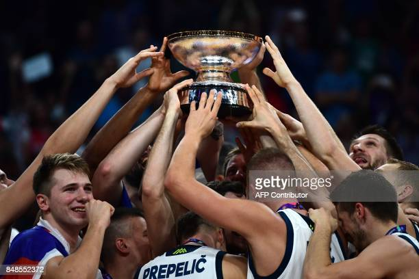 TOPSHOT Slovenia's players raise the trophy after winnig the FIBA Eurobasket 2017 men's Final basketball match between Slovenia and Serbia at Sinan...