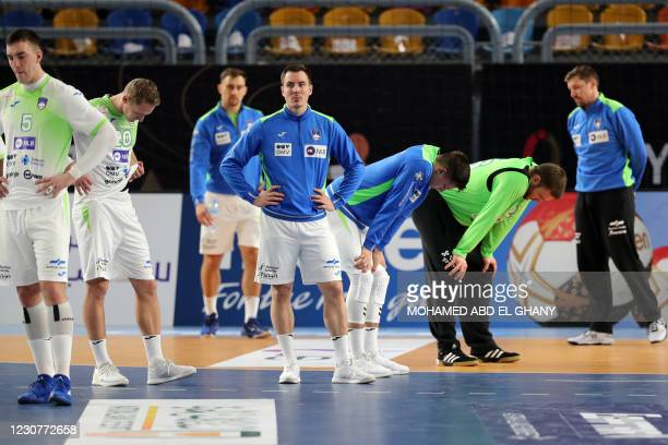 Slovenia's players react to their defeat during the 2021 World Men's Handball Championship match between Group IV teams Slovenia and Egypt at the...