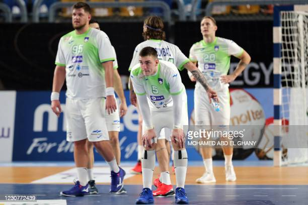 Slovenia's players react to their defeat in the 2021 World Men's Handball Championship match between Group IV teams Slovenia and Egypt at the Cairo...