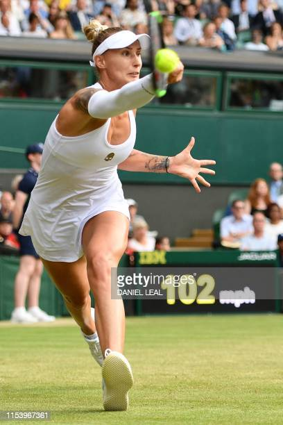 Slovenia's Polona Hercog returns against US player Cori Gauff during their women's singles third round match on the fifth day of the 2019 Wimbledon...