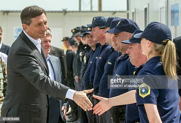 Slovenia's President Borut Pahor and his Macedonian counterpart Gjorge Ivanov meet with Croatian and Slovenian police officers deployed at...