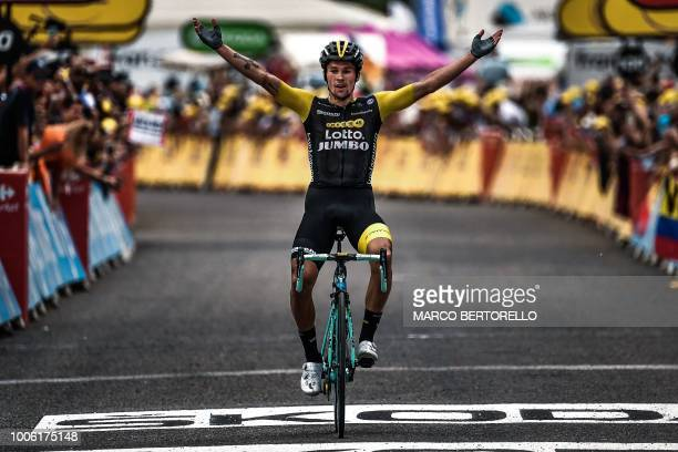 Slovenia's Primoz Roglic celebrates as he crosses the finish line to win the 19th stage of the 105th edition of the Tour de France cycling race, on...