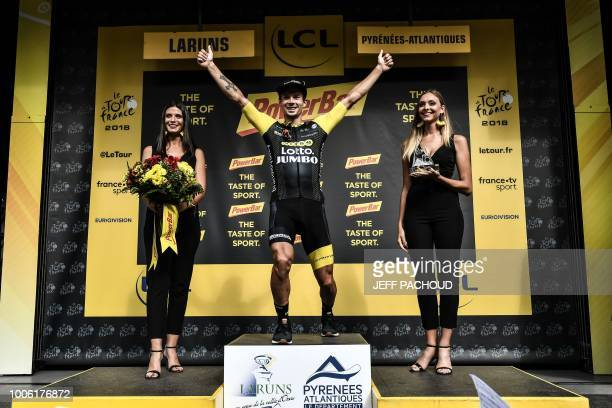 Slovenia's Primoz Roglic celebrates on the podium after winning the 19th stage of the 105th edition of the Tour de France cycling race on July 27...
