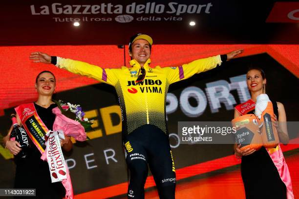 Slovenia's Primoz Roglic celebrates on the podium after winning the first stage of the 2019 Giro d'Italia the cycling Tour of Italy an 8kilometer...