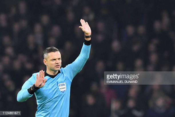 Slovenia's referee Damir Skomina gestures while refusing a goal from Ajax Amsterdam's Nicolas Tagliafico after VAR deliberation during the UEFA...