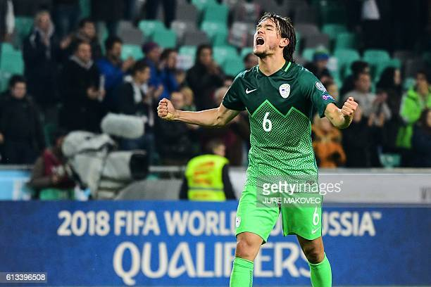 Slovenia's Rene Krhin celebrates after winning the FIFA World Cup qualifying football match between Slovenia and Slovakia at Stozice Stadium in...