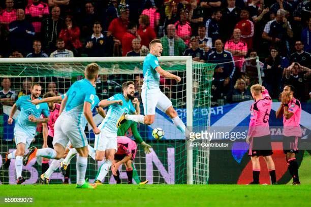 Slovenia's Roman Bezjak celebrates with his teammates after scoring a goal during the FIFA World Cup 2018 qualifier football match between Slovenia...