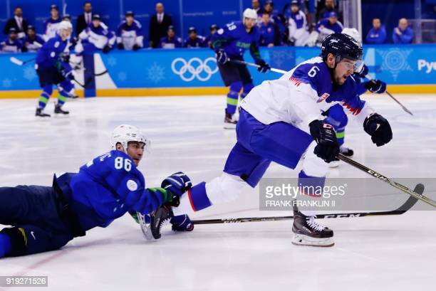 TOPSHOT Slovenia's Sabahudin Kovacevic defends against Slovakia's Lukas Cingel in the men's preliminary round ice hockey match between Slovakia and...