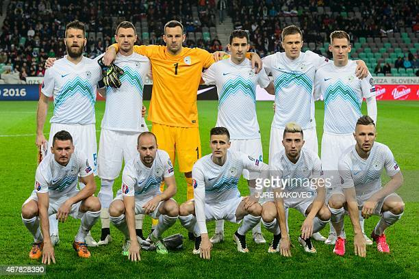 Slovenia's squad defender Bostjan Cesar forward Milivoje Novakovic goalkeeper Samir Handanovic defender Branko Ilic midfielder Josip Ilicic...