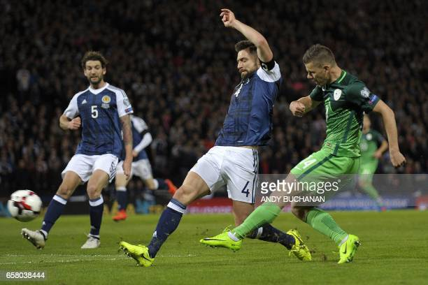 Slovenia's striker Roman Bezjak has an unsuccessful shot as Scotland's Russell Martin closes in during the World Cup 2018 qualification football...