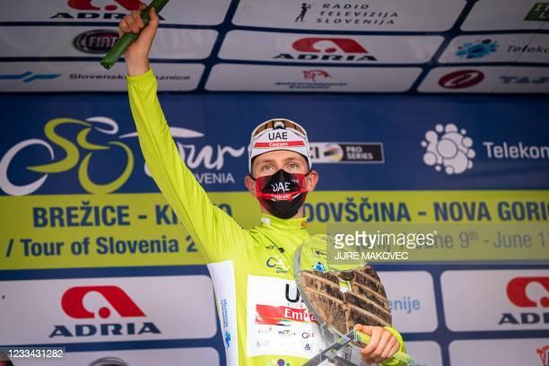 Slovenia's Tadej Pogacar of Team UAE celebrates on the podium after winning the Tour of Slovenia cycling race in Novo mesto on June 13, 2021.