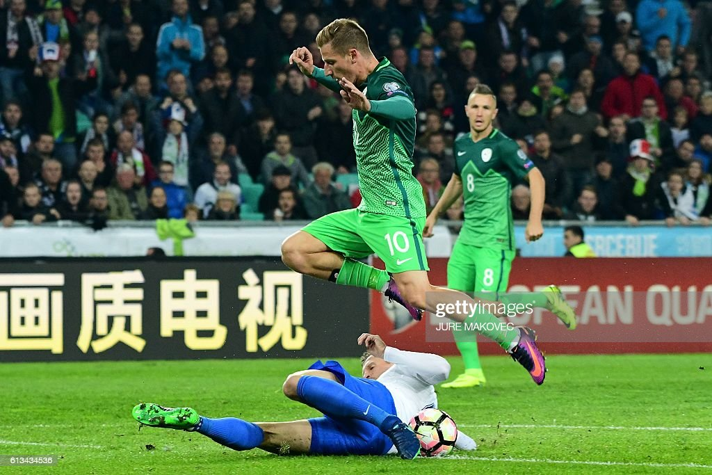 Slovenia's Valter Birsa (in air) vies for the ball with Jan Durica of Slovakia during FIFA World Cup qualifying football match between Slovenia and Slovakia at Stozice Stadium in Ljubljana on October 8, 2016. / AFP / Jure MAKOVEC