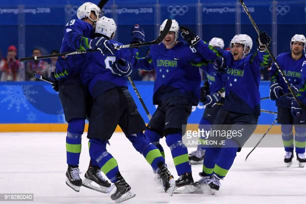 Slovenia's Ziga Jeglic is congratulated by teammates after scoring the game winning goal in a penalty-shot shootout in the men's preliminary round...