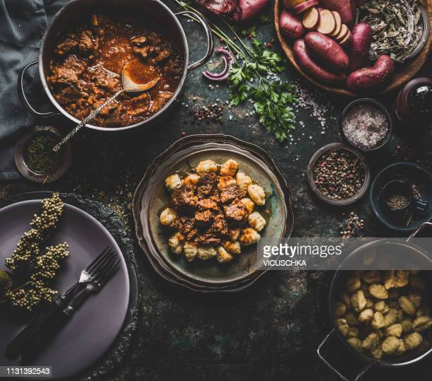slow cooked meat stew with potato gnocchi - south stock pictures, royalty-free photos & images