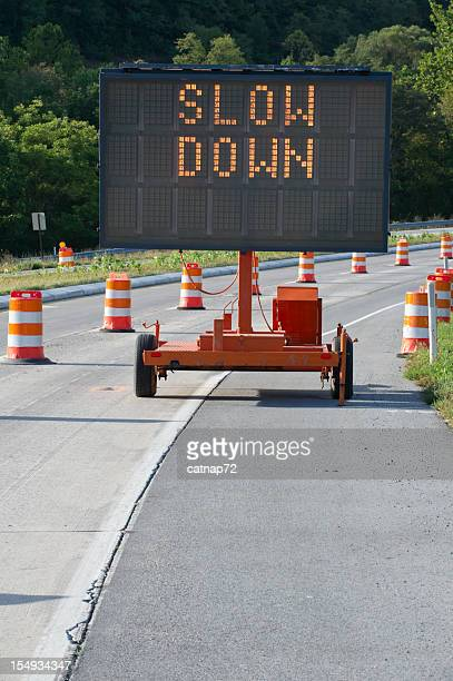 Slow Down Highway Warning Sign in Construction Zone