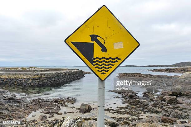 Slow down' sign seen in Errislannon village small harbour, in Connemara. On Tuesday, 3 January 2017, in Errislannon, Connemara, County Galway,...