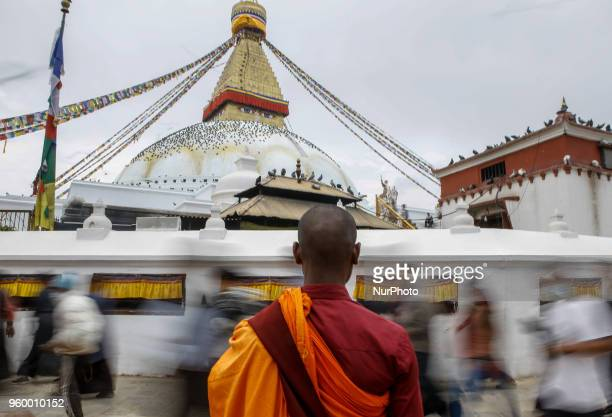 Slow motion photo of the devotees pass by while a Buddhist monk waits for the alms at the premises of Bouddhthanath Stupa in Kathmandu Nepal May 19...