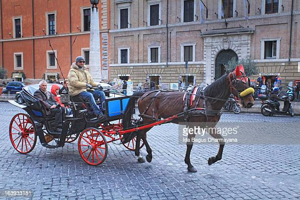 CONTENT] Slow moving beautiful horsedrawn carriage at Vatican city street