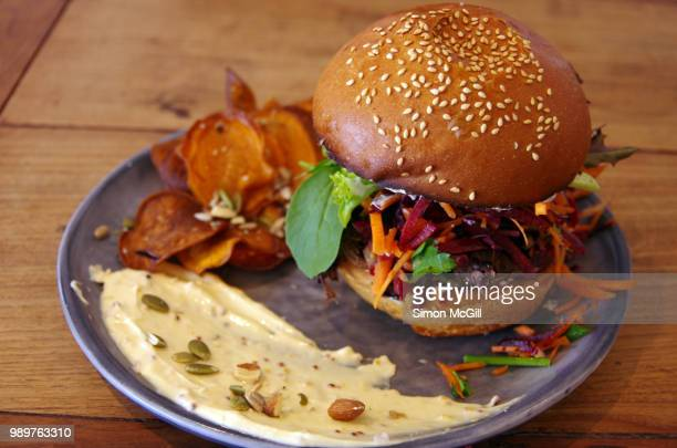 Slow roasted beef burger  with apple coleslaw and salad, served with hummous and sweet potato chips