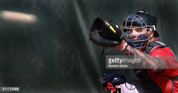 A slow shutter speed on the camera creates a comet like effect on the baseball as Boston Red Sox catcher Blake Swihart eyes a pitch thrown by pitcher...