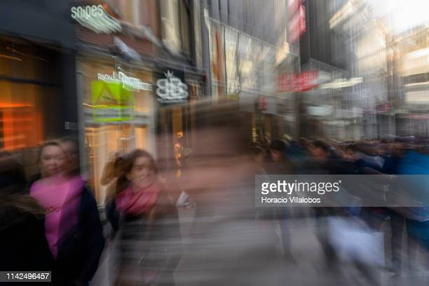 Slow shutter speed photo of tourists crowding Kalverstraat near the Royal Palace on April 13, 2019 in Amsterdam, The Netherlands. The number of...