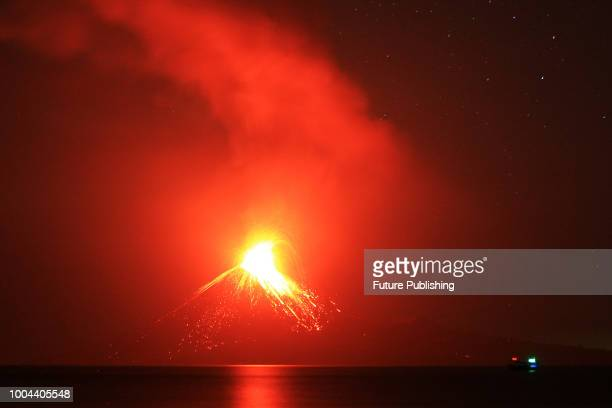 A slow shutter speed picture shows lava streaming down from Mount Anak Krakatau during an eruption as seen from Rakata island on July 19 2018 in...
