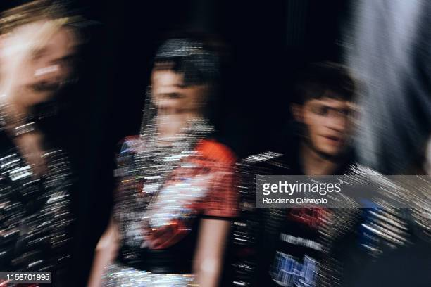 A slow shutter speed picture shows models dress textures at the Philipp Plein backstage during the Milan Men's Fashion Week Spring/Summer 2020 on...