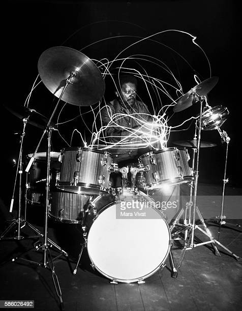 Slow shutter speed shot of acclaimed jazz musician John Ironman Harris as he plays the drums