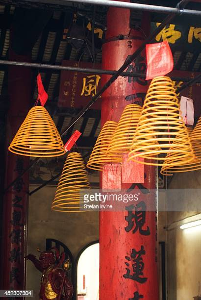 Slowburning incense coils hang from the roof at the Lin Fong Temple