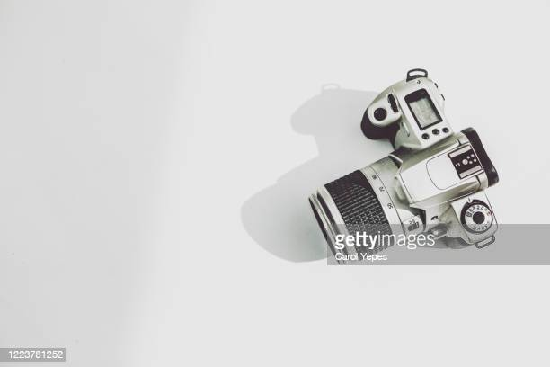 slr camera top view in white - photographic equipment stock pictures, royalty-free photos & images