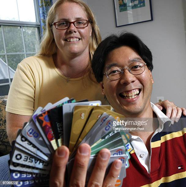 Kevin Clark/The Washington Post Neg #: 195325 Centreville, VA Michael Cheng and Nicole Cheng juggle the rewards programs through their multiple...