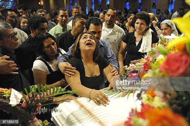 ME/Fernandez Date Kevin Clark/The Washington Post Neg # clarkk208597 Hyattsville MD Evelyn Fernandez mourns the loss of her mother Ana Fernandez at...