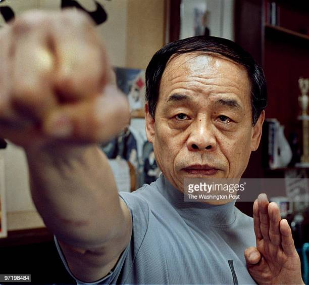 Brinkmanship Demonstrating the power of karate expert Jhoon Rhee uses only his hand to shatter a brick in Austin Texas Although deemed too ferocious...