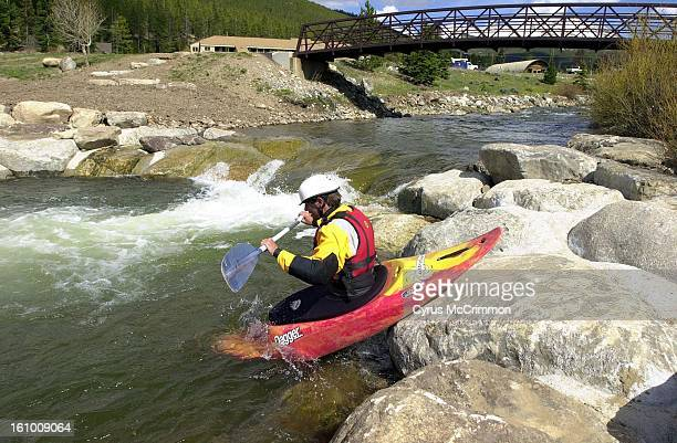 BRECK Jim Levi of Summit kayak School in Silverthorne launches himself and his kayak into the Blue River at the newly built Breckenridge Whitewater...