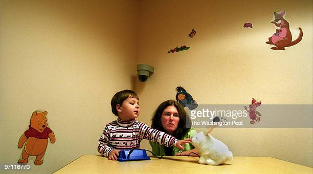 Kennedy Krieger Institute, Baltimore, Maryland--PHOTOGRAPHER-MARVIN JOSEPH/TWP--CAPTION-Behind a glass window, Dr. Rebecca Landa, Director of the...