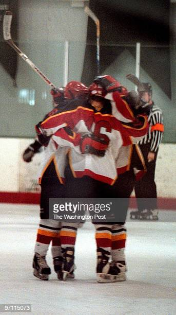 Laurel Ice House--PHOTOGRAPHER-MARVIN JOSEPH/TWP--CAPTION-Terps Hockey team versus Virginia Tech. PICTURED, The Terps have a group hug after scoring...