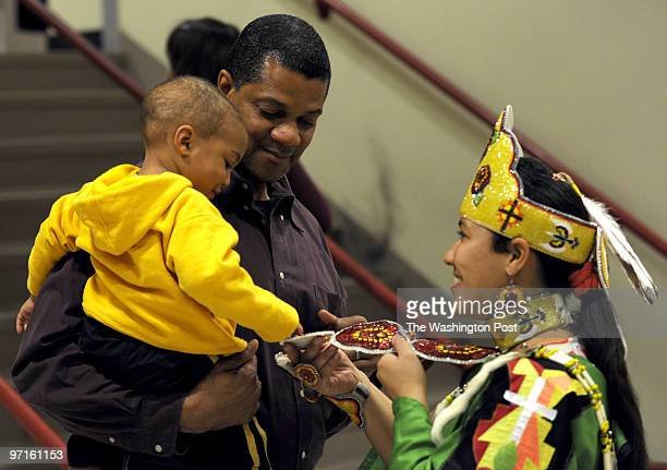 pgpowwow DATENovember 08 2008 CREDIT Mark Gail/TWP College Park Md ASSIGNMENT#204714 EDITED BY mg In the arms of his father Melvis Barrett twoyearold...