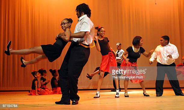 pgtheater30 DATEJuly 24 2009 CREDIT Mark Gail/TWP Forestville Md ASSIGNMENT#20936 EDITED BYmg Nia Hester goes airbound thanks to Marco Walker as they...